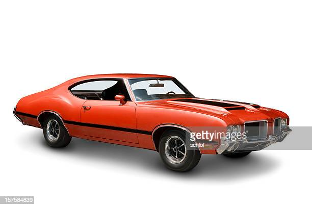 orange oldsmobile 442 against a plain white backdrop - 1970s muscle cars stock pictures, royalty-free photos & images