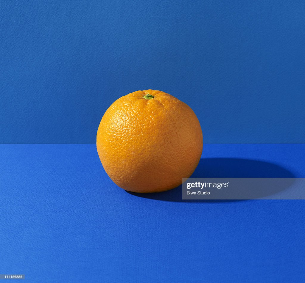 Orange fruit stock photos and pictures getty images orange on blue background altavistaventures Images