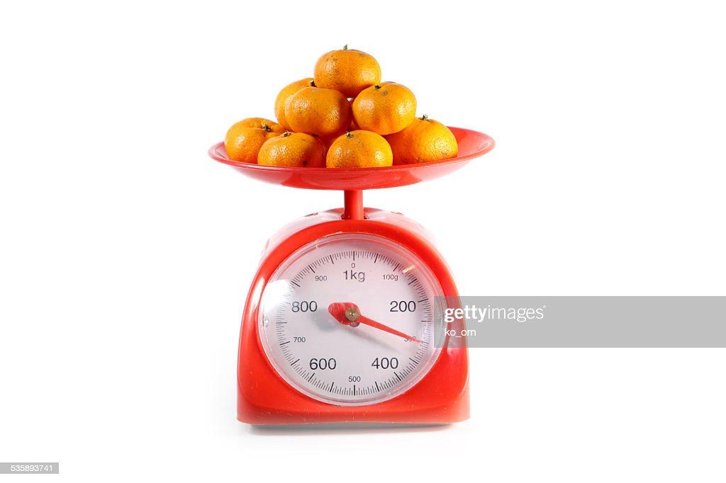 Orange on red balance : Stock Photo
