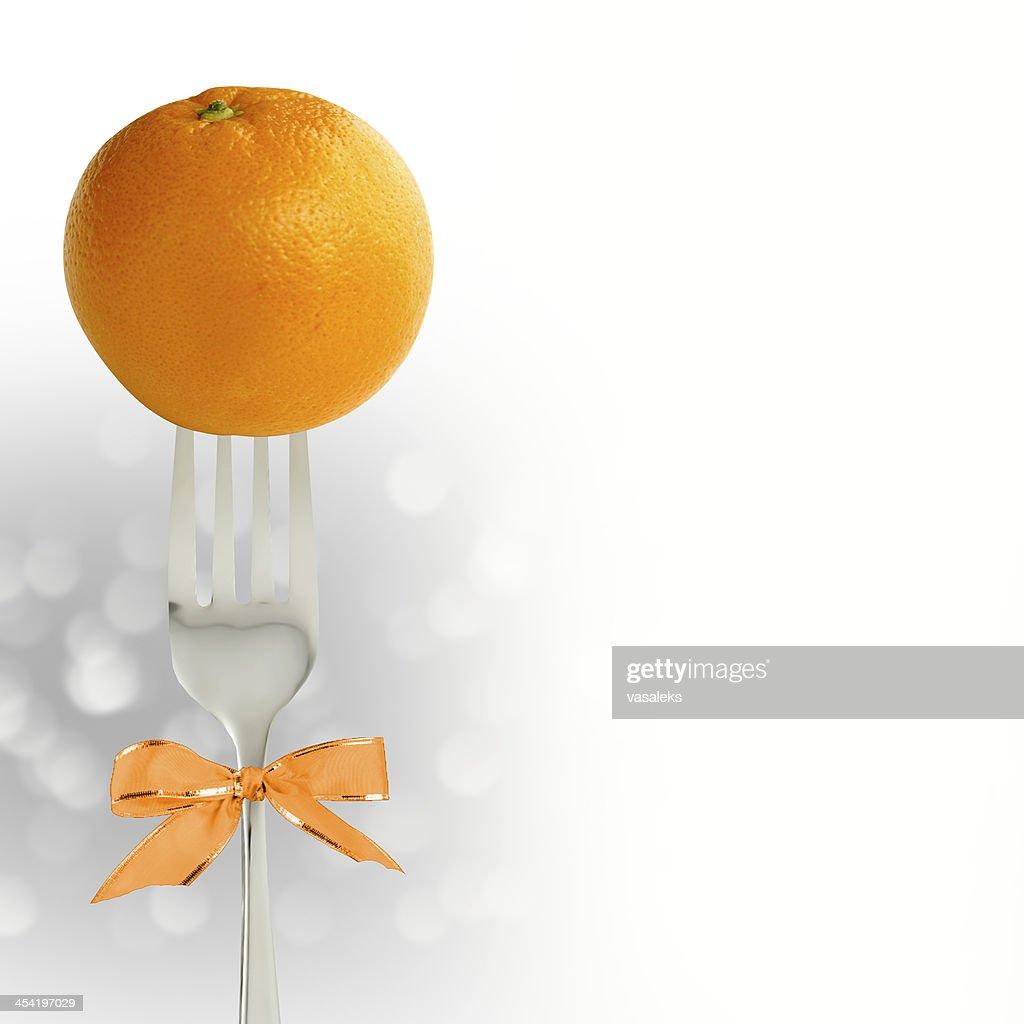 Orange on the fork : Stock Photo