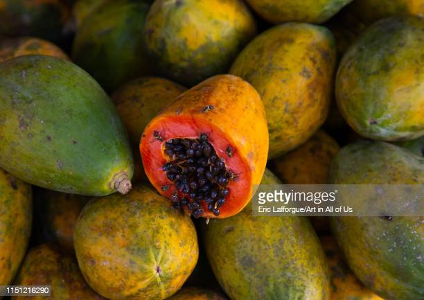 Orange open papaya with black seeds MoyenComoé Abengourou Ivory Coast on May 9 2019 in Abengourou Ivory Coast