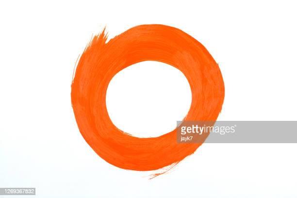 orange paint stroke - färbemittel stock-fotos und bilder