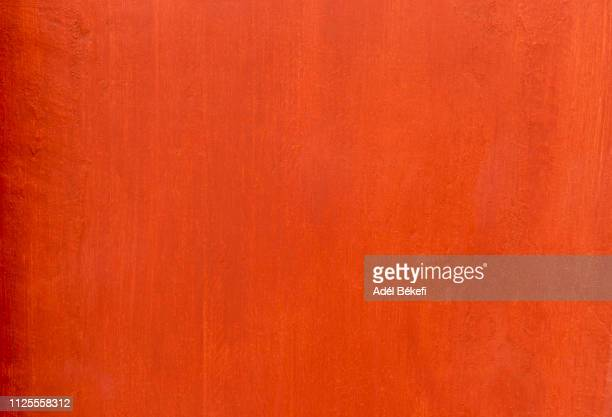 orange painted wall - paint textures stock pictures, royalty-free photos & images