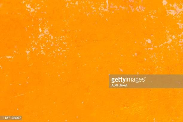 orange painted wall - orange farbe stock-fotos und bilder