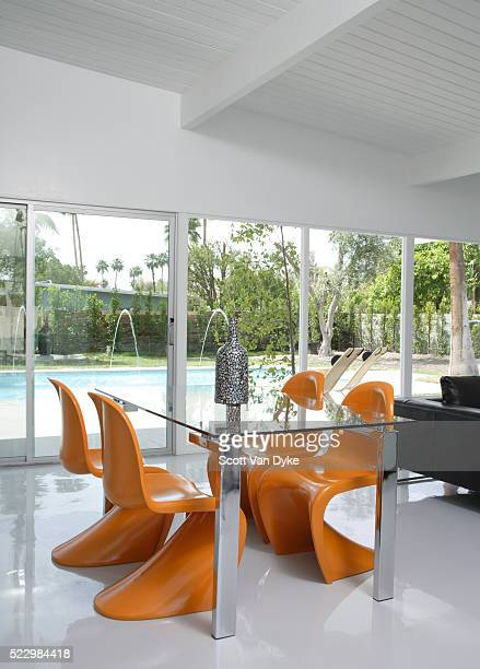 orange panton chairs for dining table - mid century modern stock pictures, royalty-free photos & images