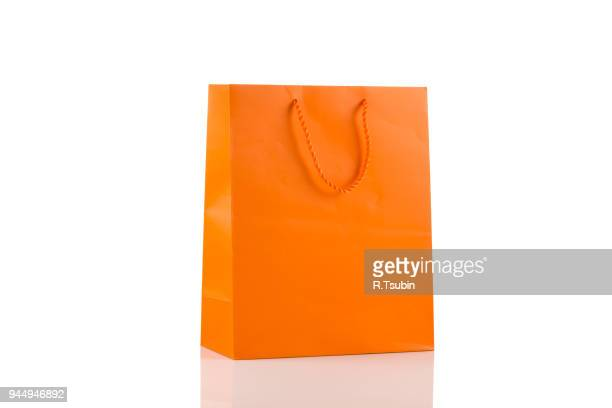 orange paper bag - shopping bag stock pictures, royalty-free photos & images