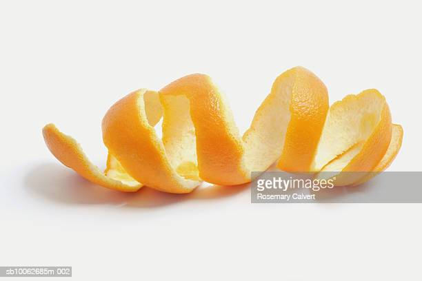 Orange peel against white background, close-up