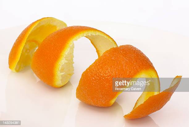 orange peel in a  coil - orange colour stock pictures, royalty-free photos & images