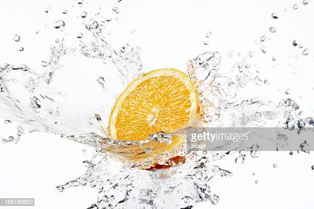 naranja - splash fotografías e imágenes de stock