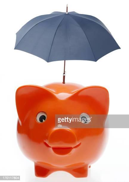 Orange Sparschwein mit blauen Schirm auf der Oberseite