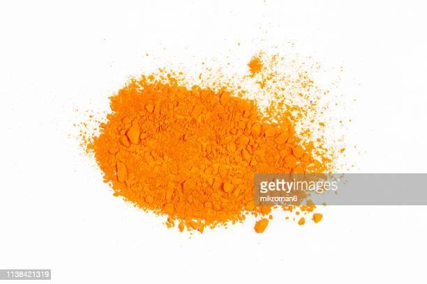 orange piles of pigment powder - talcum powder stock pictures, royalty-free photos & images