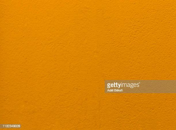 orange plastered rusty concrete wall - rust colored stock pictures, royalty-free photos & images