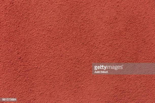 orange plastered rusty concrete wall - rust colored fotografías e imágenes de stock
