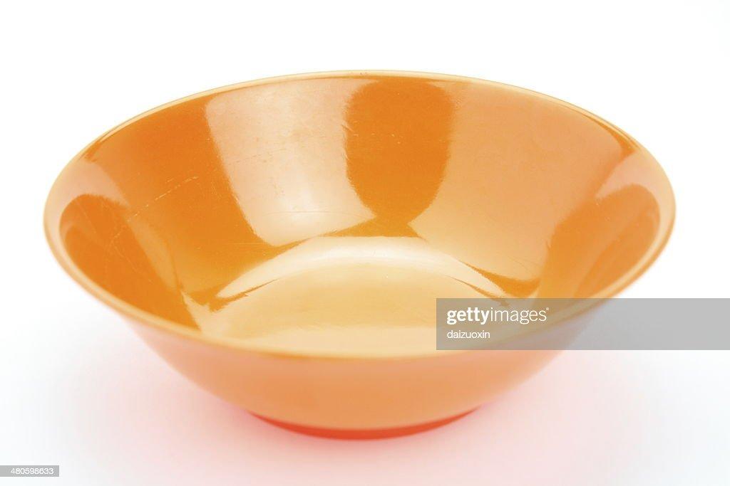Orange plastic bowl : Stock Photo