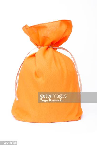 Orange pouch bag with ribbon isolated on white background