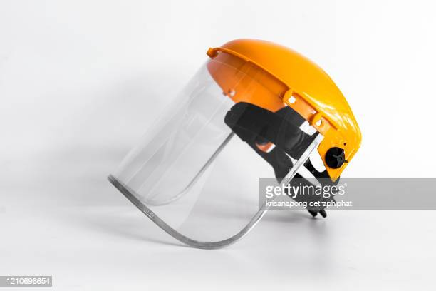 orange protective mask isolated on the white background. - helmet visor stock pictures, royalty-free photos & images