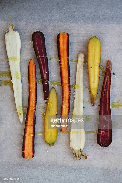 Orange, purple, white and yellow carrots