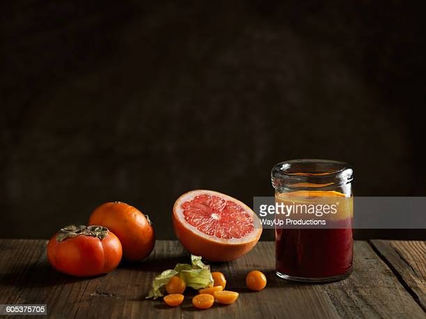 Orange raw juice in a jar with fruits