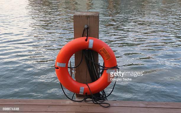 Orange Rescue flotation device near the boardwalk