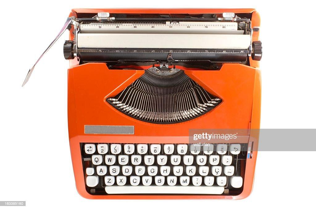 Orange retro typewriter with white keys : Stock Photo