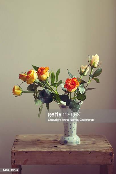 orange roses in vintage vase - vase stock pictures, royalty-free photos & images