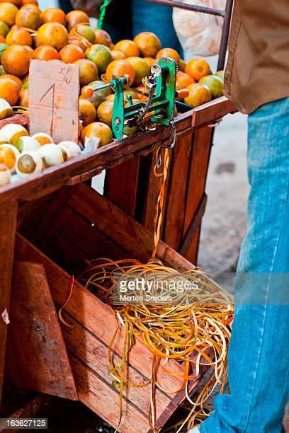 orange skin leftovers at peeling machine - 皮をむく ストックフォトと画像