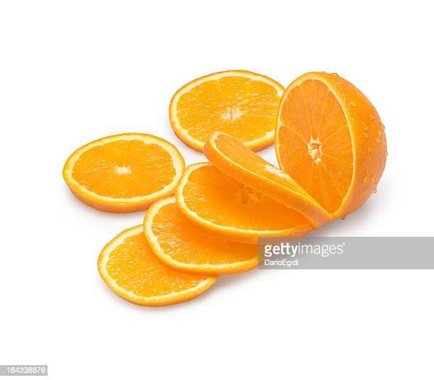 Orange slices and half orange on white background