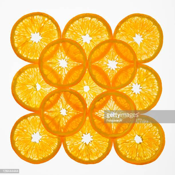 Orange slices arranged in square design on white background.
