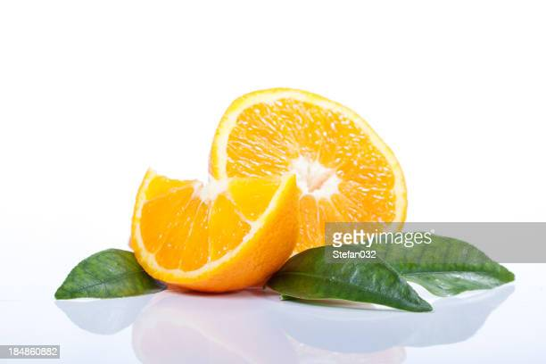 Orange slices cut next to leaves