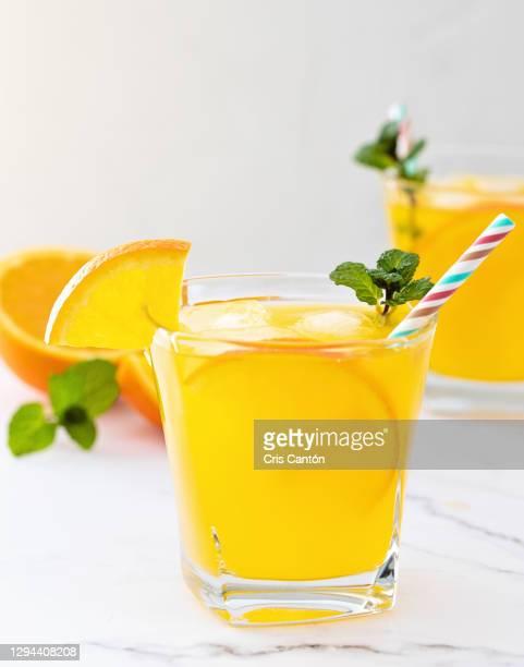 orange soda drink - cris cantón photography fotografías e imágenes de stock