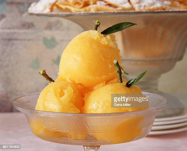 orange sorbet dessert in glass dish, close-up - sorbet stock pictures, royalty-free photos & images