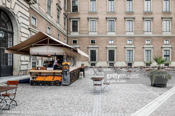 orange stand in swedish palace courtyard - angela auclair stock pictures, royalty-free photos & images