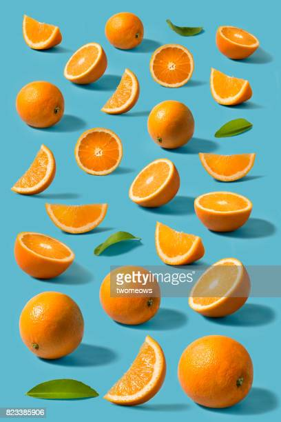 orange still life on blue background. - arancione foto e immagini stock