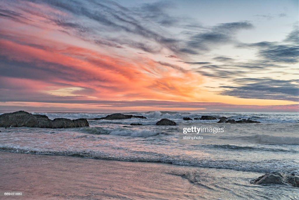 Orange sunset at the beach. : Stock Photo