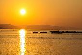 orange sunset at sea sun reflection