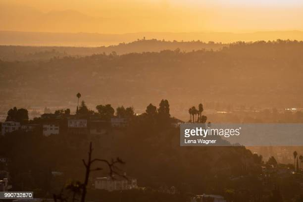 orange sunset over hollywood hills - hollywood hills stock pictures, royalty-free photos & images