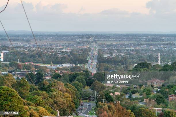 orange sunset over suburban melbourne | australia - dandenong stock photos and pictures