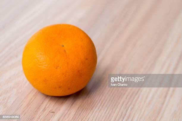Orange Tangerine on Wooden Table