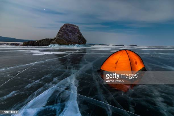 orange tent on the ice of lake baikal at night - explore stock photos and pictures