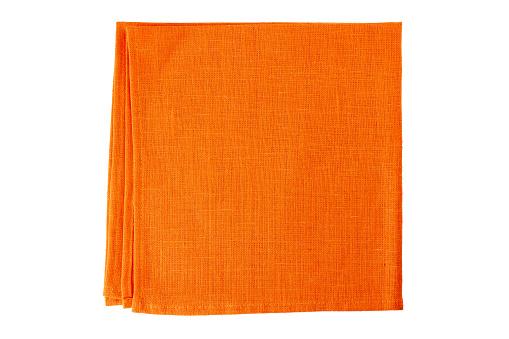 Orange textile napkin on white 653973244