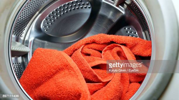 orange towel in washing machine - towel stock pictures, royalty-free photos & images