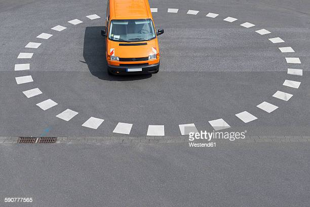 Orange van parking at roundabout