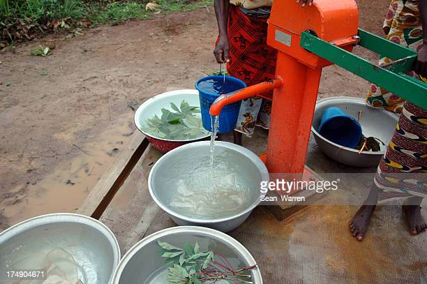 Orange village water fountain with bowls around it