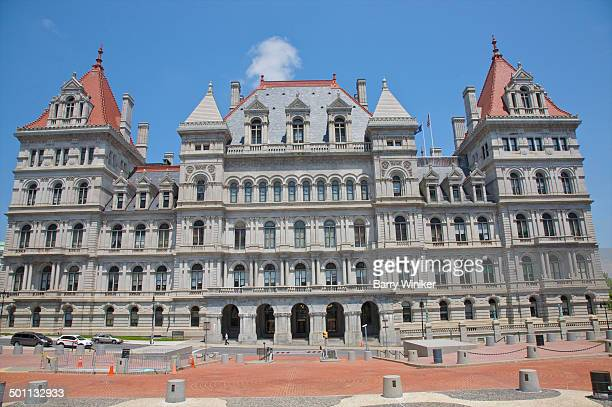 orange walkway below elaborate capitol building - ニューヨーク州庁舎 ストックフォトと画像