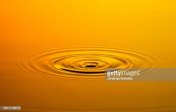orange water ripple - rippled stock pictures, royalty-free photos & images