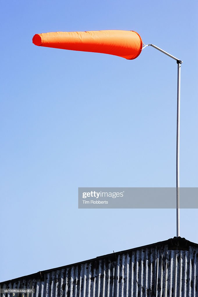 Orange windsock against blue sky : Stock Photo