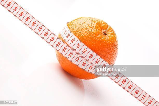 Orange with measurement tape