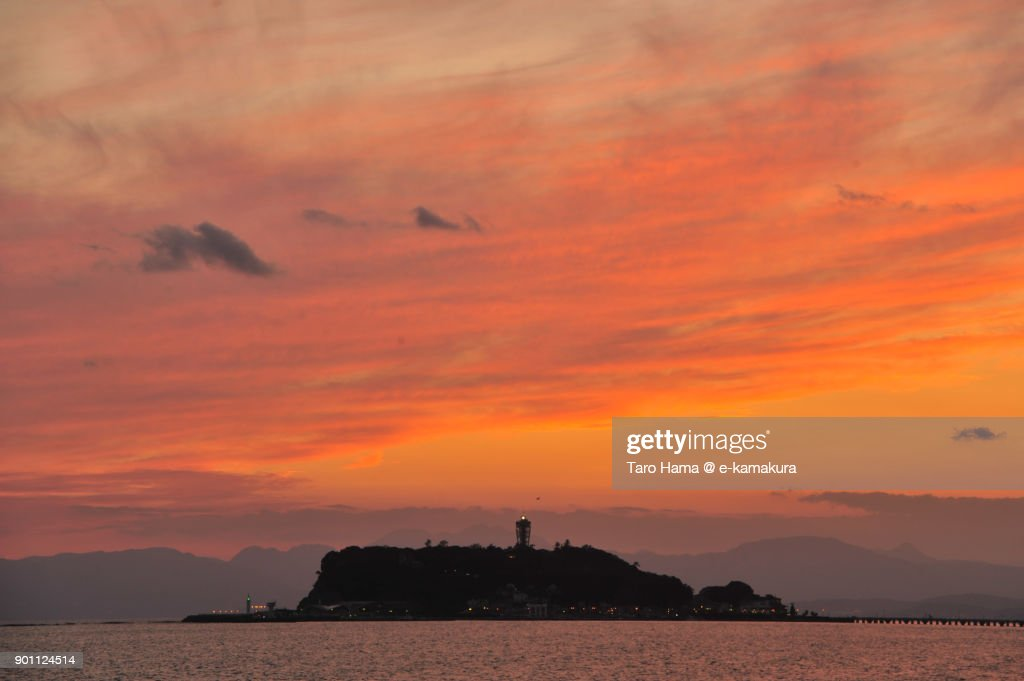 Orange-colored clouds on Enoshima Island in Fujisawa city in Kanagawa prefecture in Japan after sunset : ストックフォト
