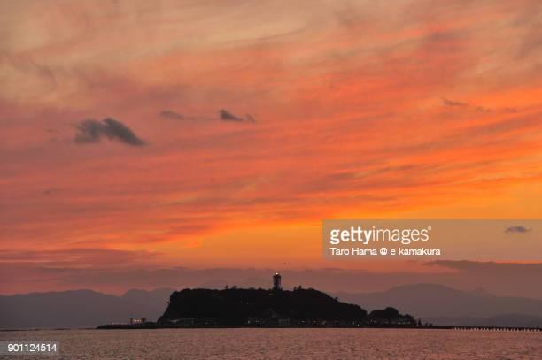 Orange-colored clouds on Enoshima Island in Fujisawa city in Kanagawa prefecture in Japan after sunset