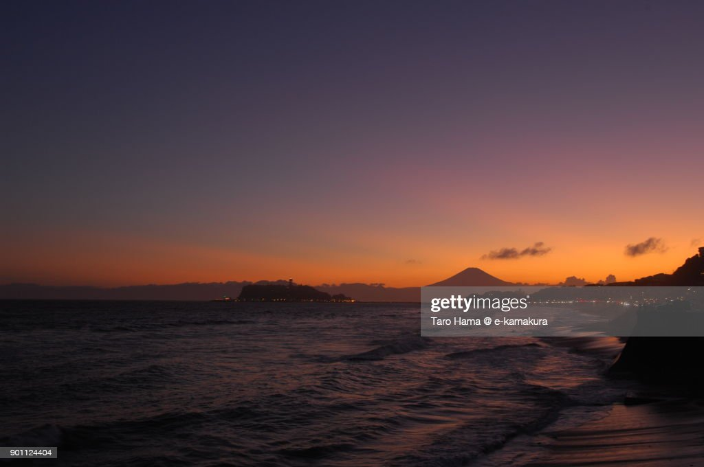 Orange-colored clouds on Mt. Fuji and Enoshima Island in Fujisawa city in Kanagawa prefecture in Japan after sunset : ストックフォト